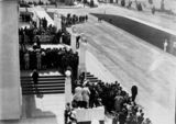 Picture relating to Parliament House - titled 'Opening of the 16th Parliament, spectators watching the entrance of Governor-General in front of Old Parliament House.'