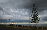 Picture relating to Werribee South - titled 'Storm brewing over new flagpoles at Werribee South'