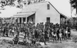 Picture relating to Townsville - titled 'South Sea Islanders outside a plantation building, Townsville, ca. 1870'