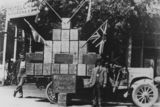 Picture relating to Charleville - titled 'Motor vehicle in Charleville loaded with Shell fuel tins, 1919'