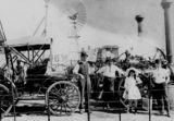 Picture relating to Rockhampton - titled 'Display of motor vehicles and agricultural machinery at the Rockhampton Showgrounds, Queensland, ca. 1907'