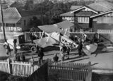 Picture relating to Queensland - titled 'De Havilland DH60 K Moth being loaded onto a truck after landing in a suburban street'