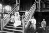 Picture relating to Gatton - titled 'Brunnich family posing on and around the front stairs of their home at Gatton, Queensland, 1900'