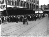 Picture relating to Brisbane - titled 'Crowd gathered for free lunch outside McWhirters' building, Fortitude Valley, Brisbane, 1933'
