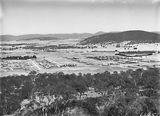 Picture relating to Braddon - titled 'Braddon, Reid and Civic Centre from Mt Ainslie. Ainslie Hotel, Limestone Avenue in foreground. Black Mountain in background.'