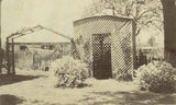 Picture relating to Toowoomba - titled 'Lattice covered bush house in the grounds of Enniskillen House, Toowoomba, ca. 1925'