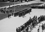 Picture relating to Parliament House - titled 'Armistice Day Ceremony with the Royal Military College Cadets on parade in front of Old Parliament House. Inspection by Prime Minister Scullin.'