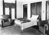 Picture relating to Parliament House - titled 'Speakers Room, Old Parliament House. The bed folded into the cupboard directly behind it.'