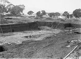 Picture relating to Acton - titled 'Excavation for the foundations of the Australian Institute of Anatomy. McCoy Circle, Acton, Beaucham House on the right.'