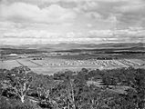 Picture relating to Brindabella - titled 'Reid from Mt Ainslie. Brindabellas on the horizon.'
