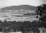 Picture relating to Ainslie - titled 'Braddon and Civic Centre from Mt Ainslie. Ainslie Hotel in centre.'