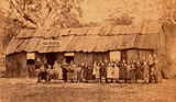 Picture relating to Stanthorpe - titled 'Schoolchildren standing in front of Stanthorpe's first school, ca. 1872'