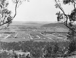 Picture relating to Reid - titled 'Reid, Braddon and Civic Centre. Ainslie Hotel in centre. Black Mountain on right.'