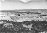 Picture relating to Parliament House - titled 'View from Mt Ainslie along Anzac Parade and Reid to Old Parliament House'