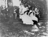 Picture relating to Fraser Island - titled 'Ruby Byrne and Irene Askew reading outdoors in the shade, Fraser Island, ca. 1903'