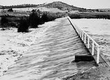 Picture relating to Kingston - titled 'Footbridge over the weir on the Molonglo River behind the Kingston Power Station which led to Duntroon'