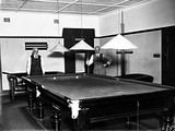 Picture relating to Barton - titled 'Brassey House billiard Room with players, Macquarie Street, Barton.'