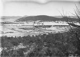 Picture relating to Black Mountain - titled 'Braddon and Civic Centre from Mt Ainslie. Ainslie Hotel, Limestone Avenue in foreground. Black Mountain in background.'