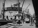 Picture relating to Brisbane - titled 'Ships loading at Eagle Street Wharves, Brisbane, Queensland, ca. 1935'