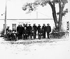 Picture relating to Acton - titled 'Group of policemen with helmets, outside Acton Courthouse, Troopers with motor cycle combinations and horses.'