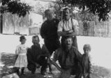 Picture relating to Queensland - titled 'Group of four men and two children at an unidentified location, 1900-1910'