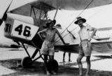 Picture relating to Lowood - titled 'Two servicemen standing beside a Tiger Moth, Lowood, ca. 1941'