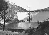 Picture relating to Cotter Dam - titled 'Cotter Dam Wall overflowing into the stilling pond'