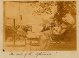 Picture relating to Mackay - titled 'Charles and Winifred Rawson resting on the verandah of The Hollow'