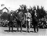 Picture relating to Canberra - titled 'Group of four people including Mr H J H Honeyset, Canberra Community News.'