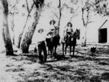 Picture relating to Queensland - titled 'Two girls on horses and a woman with a camera, 1915'
