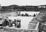 Picture relating to Kingston - titled 'Manuka swimming pool under construction, wall tiles being installed, Manuka Circle, Kingston.'