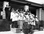 Picture relating to Canberra - titled 'Group of Roman Catholic clergy including Archbishop Mannix in front of Hotel Canberra'