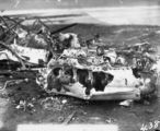 Picture relating to Barton - titled 'Aircraft crash showing engine - Single seat Scout Experimenter prefix A2 crashed at the opening of Parliament on 9 May 1927 on Rottenbury Hill at the site of St Marks Church, Blackall Street, Barton - Pilot Flying Officer EWEN was killed and is buried in St John's churchyard - See Canberra Times 13 May 1927 for details.'