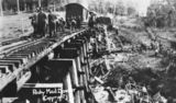 Picture relating to Traveston - titled 'Workers repairing the damaged railway track at the Rocky Mail disaster, near Traveston, 1925.'