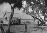 Picture relating to Longreach - titled 'Family sitting in front of their home at Longreach, Queensland, ca. 1890'
