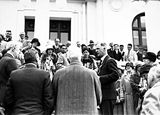Picture relating to Parliament House - titled 'Visiting American tourists from the SS Malolo with Prime Minister Scullin in front of Old Parliament House'