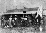 Picture relating to Widgee - titled 'Group of people in front of W.Wilson's Hotel at Widgee'
