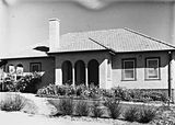 Picture relating to Parkes - titled 'Oakley and Parkes Cottage and gardens on National Circuit, Forrest.'