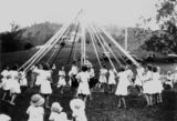 Picture relating to Canungra - titled 'Children doing maypole dancing in the Canungra Showgrounds, ca. 1934'