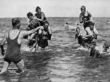 Picture relating to Queensland - titled 'Young people playing in the sea, 1933'