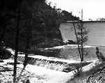 Picture relating to Cotter Dam - titled 'Cotter Dam wall and stilling pond, below the spillway.'