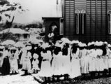 "Picture relating to Cooktown - titled 'Group of young girls attired in their ""Sunday best"" frocks outside St Mary's Catholic Church at Cooktown in 1907'"
