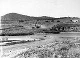 Picture relating to Mount Ainslie - titled 'Crawler tractors and scoop excavating for a road and bridge at Scotts Crossing near the Monoglo River. Mount Ainslie on left, Russell Hill on right. Blundel cottage on right.'