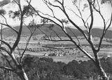 Picture relating to Ainslie - titled 'Braddon from Mt Ainslie to Black Mountain, Ainslie Hotel, Limestone Avenue in the centre.'