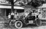 Picture relating to Maleny - titled 'Men, women and children gathered on and around the first motor car in Maleny, Queensland, 1913'