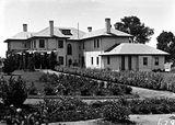 Picture relating to Deakin - titled 'Prime Ministers Lodge from the west, Adelaide Avenue, Deakin.'