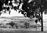 "Picture relating to Red Hill - titled 'View from Red Hill towards Duntroon - Hotel Wellington in centre. under construction. Oakley and Parkes "" Forrest Park ""homes in foreground.'"