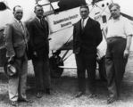 Picture relating to Queensland - titled 'Four men standing in front of a DH50A aeroplane called Western Star, ca. 1933'