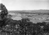 Picture relating to Parliament House - titled 'View from Mount Ainslie along Anzac Avenue towardsOld Parliament House'