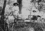 Picture relating to Queensland - titled 'Woman with a child in a goat cart, 1900-1910'